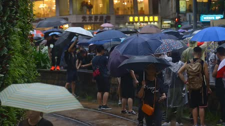 crowded : Hongkong, China - August 2019: busy crowded asian street. people pedestrians with umbrellas walking on sidewalk. hongkong, overcrowded, rush hour, traffic concept