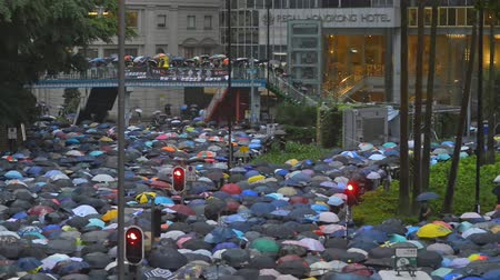 crowded : Hong Kong, China conflict - August 2019: protests Anti-extradition bill protesters. crowded street with people in rain umblellas. peaceful march walking through streets