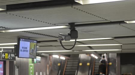 sistemas : Hongkong, China - August 2019: cctv camera security controlling metro subway escalator to prevent crime. safety surveillance protection. video monitoring recording closeup. concept technology, privacy, asia. in airport