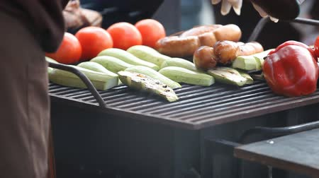 vegetable marrows : sausage and vegetables tomatoes peppers aubergines fried on the grill Stock Footage