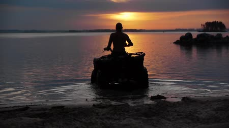 atv : Quad bike rides into the sunset. Stock Footage