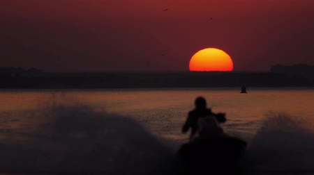 mono lake : Jet ski sunset HI Stock Footage