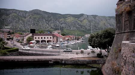 famous pace : Berth Fortress. Quickening, taymlaps. Fuss coastal town cars, yachts, people, all in a hurry. Bridge over the small bay, where boats are parked, and only leaves in a small pond living at their own pace - they are not hurry. Stock Footage