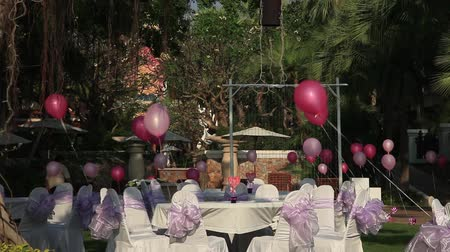 event : Stock Video Footage 1920x1080 The eve of Valentines Day, celebration on open-air restaurant in the hotel,?reparation for corporate events, covered tables decorated with hearts and balloons, pink party, holiday, birthday, wedding