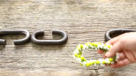 doesnt : A chain is only as strong as its weakest link hand putting inserting weak link made of flowers Stock Footage
