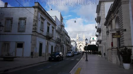 ss : ALBEROBELLO, ITALY - December, 18: Street leading to Saint Cosma and Damiano Basilica on December, 18, 2013, Alberobello, Italy. Alberobello is UNESCO World Heritage Site highly visited all year round Stock Footage