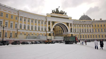 alexander column : SAINT PETERSBURG, RUSSIA - FEBRUARY, 20: Grader cleaning Dvortsovaya (or Palace) square from snow on February 20, 2013, Saint Petersburg, Russia. Palace square is historical center of St.Petersburg with many landmarks on it Stock Footage
