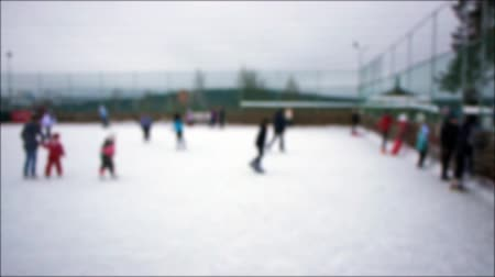 patim : People skating on ice-rink, defocused