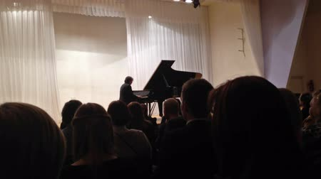 ruský : PETROZAVODSK, RUSSIA - March 03, 2013: Russian classical pianist Vladimir Mischouk, honoured artist of Russia,  playing Chopin on Petrozavodsk philharmonic stage.
