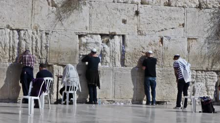 wailing wall : JERUSALEM, ISRAEL - NOVEMBER 11, 2011: True believers in white kippah praying near Western Wall (Wailing Wall or Kotel). Stock Footage