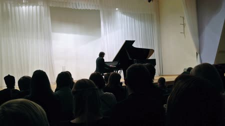 fortepian : PETROZAVODSK, RUSSIA - March 03, 2013: Russian classical pianist Vladimir Mischouk playing Chopin on philharmonic stage.