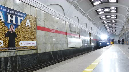 závod : SAINT PETERSBURG, RUSSIA - NOVEMBER 23, 2014:  Metro Train Arrives at the Station Kirovsky Zavod. St.Petersburg subway is the deepest underground in the world, serves 2.15 million passengers daily