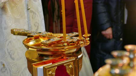 baptismal : Golden Bowl for Blessing of Waters with Cross and Burning Candles at Epithany Day