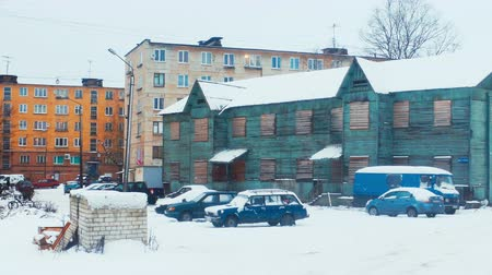 wall building feature : KONDOPOGA RUSSIA  DECEMBER 20 2014: Wooden Barrack House near Block of Flats in Russian Town in Cold Winter Day Shot in 4K Ultra High Definition