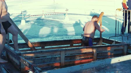 baptismal : PETROZAVODSK RUSSIA  JANUARY 19 2015: Traditional Ice Swimming at Epithany Day in Russia. Special IceHoles are Being Made All Over Russia in This Day Stock Footage