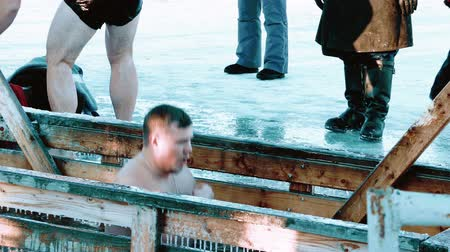 baptismal : PETROZAVODSK, RUSSIA - JANUARY 19, 2015: Traditional Ice Swimming at Epithany Day in Russia. Special Ice-Holes are Being Made All Over Russia in This Day