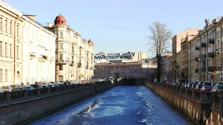 atlanti : SAINT PETERSBURG, RUSSIA - MARCH 18, 2015:  Panoramic View to Griboedov Channel Embankment. Bas-Reliefs are on Building Walls, Shot in 4K Ultra HD