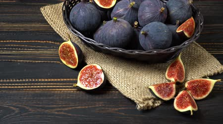 antioxidant : Fresh and dried Fig isolated on wooden background Stock Footage