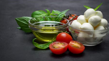 olasz konyha : Ingredients for caprese salad - Mozzarella, tomatoes, basil leaves, olive oil