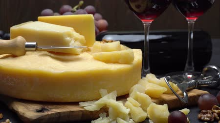 parmigiano : Video Whole round Head of parmesan or parmigiano hard cheese, grapes and wine