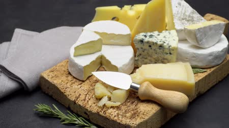 parmazán : Video of various types of cheese - parmesan, brie, roquefort