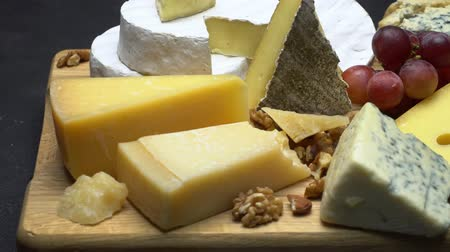 parmigiano : Video of various types of cheese - parmesan, brie, roquefort