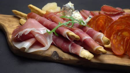 grissini : Video of italian meat plate - sliced prosciutto, sausage, grissini and parmesan Stock Footage