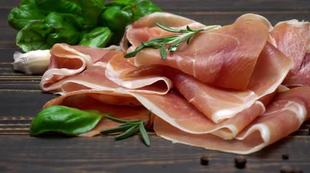 jamon : sliced prosciutto or jamon meat on wooden background