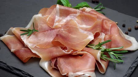 jamon : sliced prosciutto or jamon meat on concrete background