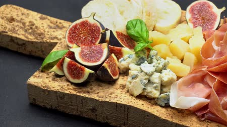 jamon : traditional cheese and meat plate wth parma, parmesan and figs Stock Footage
