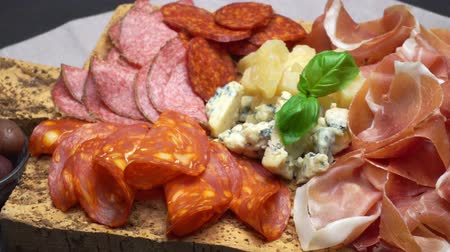 smoked : traditional cheese and meat plate wth parma, parmesan and figs Stock Footage