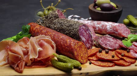 вылеченный : salami and chorizo sausage close up on a wood board