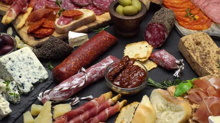 соленья : various types of italian food - cheese, sausage and tomatoes
