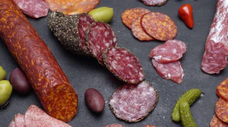 kapary : salami and chorizo sausage close up on dark concrete background Dostupné videozáznamy