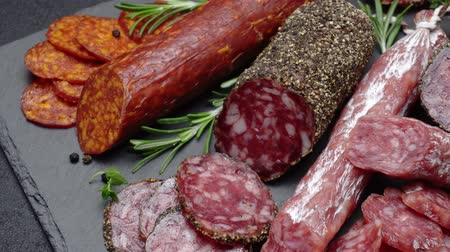 вылеченный : salami and chorizo sausage close up on stone serving board