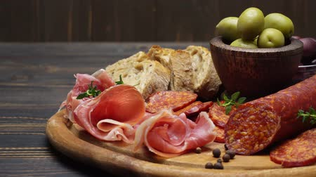 smalec : sliced prosciutto and salami sausage on a wooden board