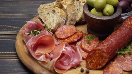 jamon : sliced prosciutto and salami sausage on a wooden board