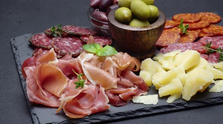 parmigiano : sliced prosciutto, cheese and salami sausage on stone serving board