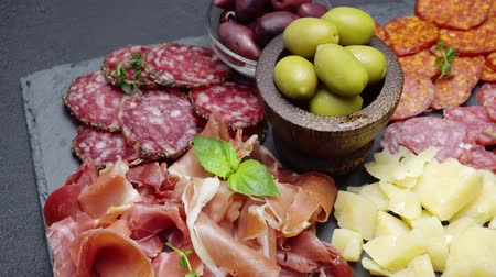 jamon : sliced prosciutto, cheese and salami sausage on stone serving board