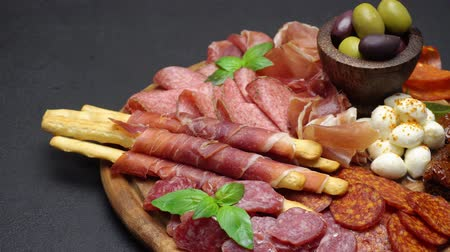 grissini : Video of italian meat plate - sliced prosciutto, sausage and grissini