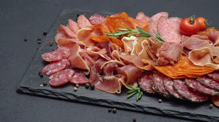 jamon : meat plate - sliced prosciutto and salami sausage on stone serving board