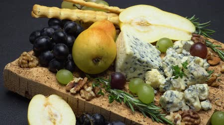 dorblu : blue cheese and fruits on cork wooden serving board