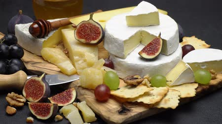 parmigiano : Video of various types of cheese - parmesan, brie, cheddar