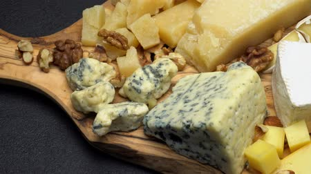 dorblu : various types of cheese - brie, camembert, roquefort and cheddar