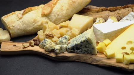 orzech : various types of cheese - brie, camembert, roquefort and cheddar