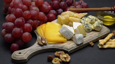 dorblu : Video of various types of cheese - parmesan, brie, cheddar and roquefort