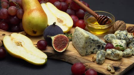 dorblu : Video of roquefort or dorblu cheese and grapes