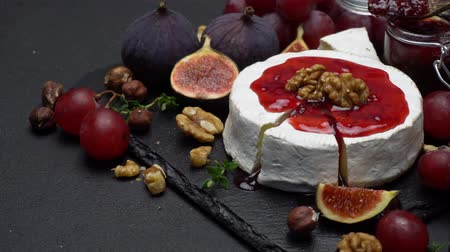 kekik : Camembert cheese and walnuts on stone serving board