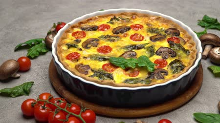 gombák : Baked homemade quiche pie in ceramic baking form Stock mozgókép