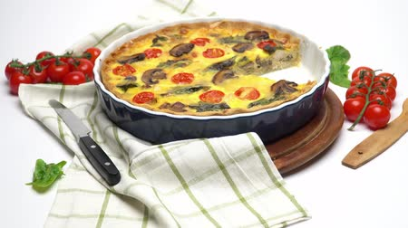 cheese slice : Baked homemade quiche pie in ceramic baking form Stock Footage